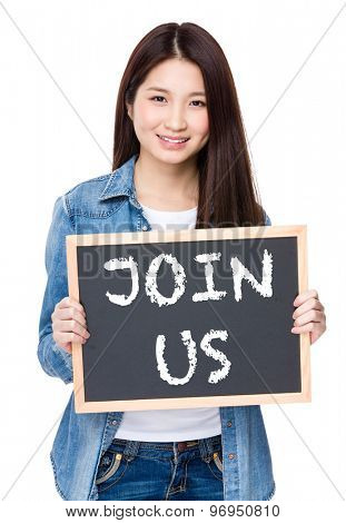 Young woman hold with chalkboard showing phrase of join us