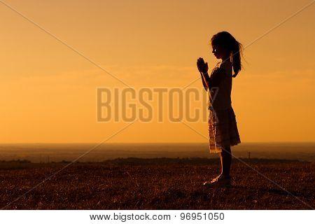 Little girl meditating