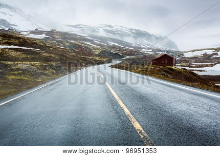 Mountain road in Norway, around the fog and snow.