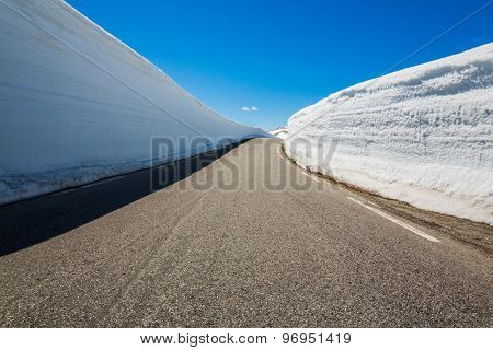 Mountain road in Norway with high snow wall