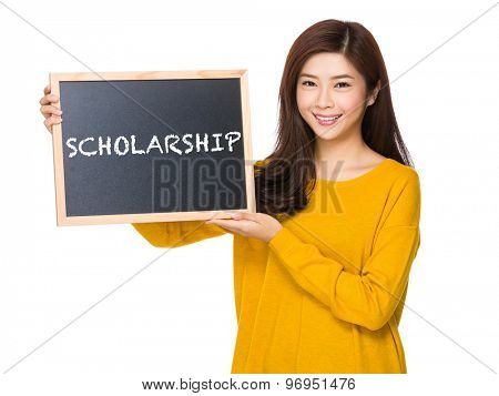 Young woman hand hold with the blackboard showing a word of scholarship