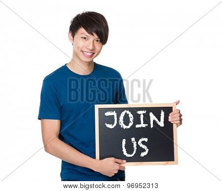 Asian man with the blackboard showing a phrases of join us