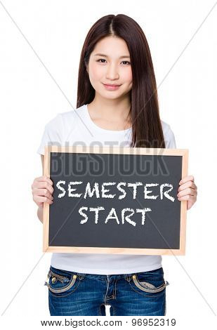 Asian young woman hold with chalkboard showing phrase of semester start