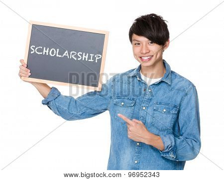 Asian man finger point to chalkboard and showing a word scholarship