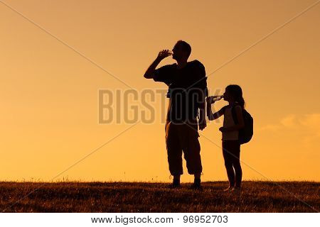 Refreshment for father and daughter hikers