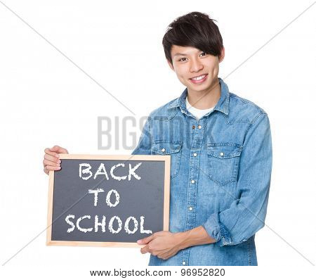 Man hold with blackboard showing phrases of back to school