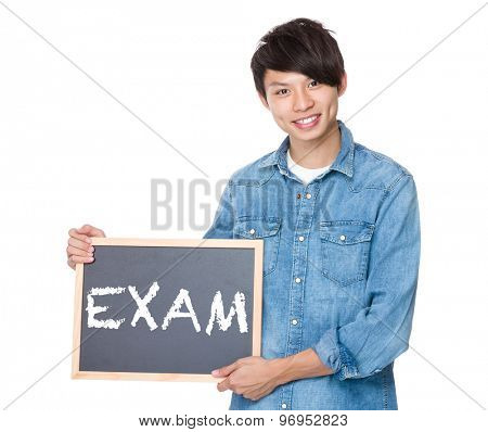 Man hold with blackboard showing a word exam