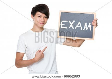 Man hold with chalkboard showing a word exam