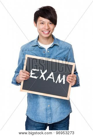 Asian young man with chalkboard showing a word exam