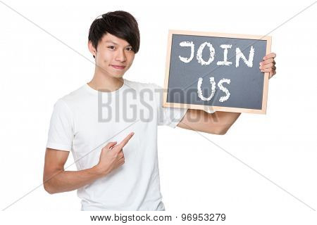 Man hold with chalkboard showing a phrases of join us