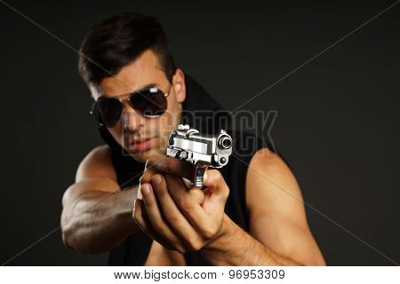 Young man with a gun