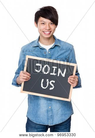 Asian young man with chalkboard showing a phrases of join us