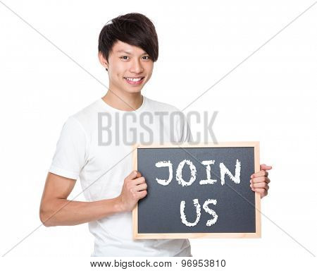 Young university student with blackboard showing a phrases of join us