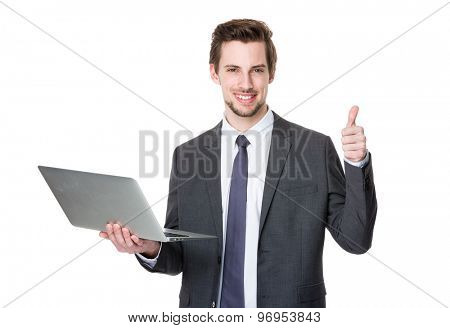Caucasian businessman use of laptop and thumb up