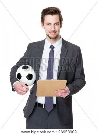 Football manager hold with soccer ball and clipboard