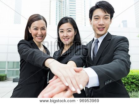 Group of business people with all hand together