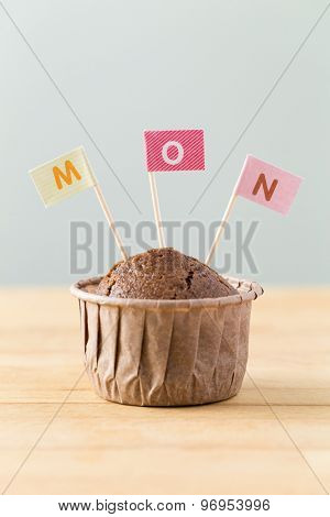 Chocolate muffins with small flag of a word mon