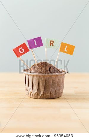 Chocolate muffins with small flag of a word girl