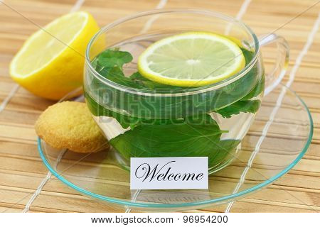 Welcome card with cup of mint tea with lemon