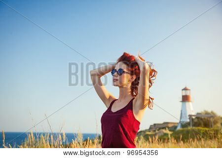 Girl With Sunglasses Near Lighthouse
