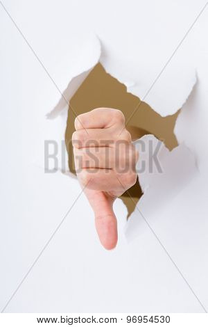 Thumbs down sign from paper hole