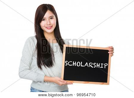 Young woman hold with chalkboard showing a word scholarship