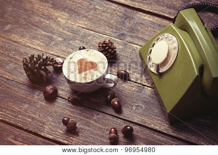 Cup Of Coffee With Heart Shape And Green Dial Phone