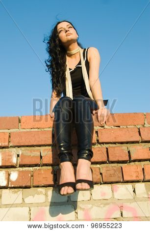 Pretty girl sitting on roof