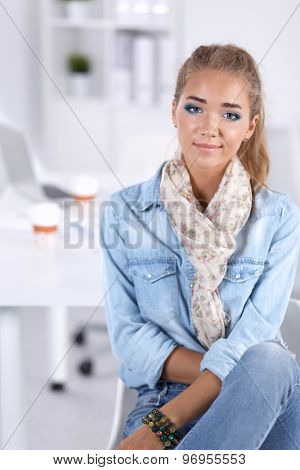 Attractive young  woman standing in office, isolated
