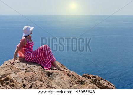 Woman In A Long Summer Dress In Greece, Santorini.