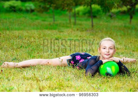 flexible little blondie girl doing gymnastics horizontal split