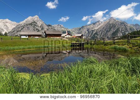 Mountain Landscape with with a lake in the foreground. Austria Tirol Walderalm.