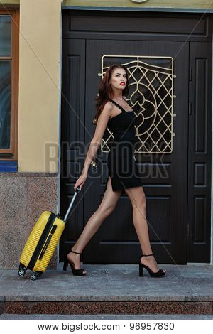 Girl Goes And Carries A Suitcase On Wheels.