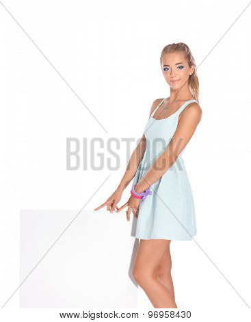 Young woman standing isolated on white background.