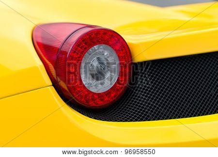 Close-up View Of Yellow Sports Car Rear Light.