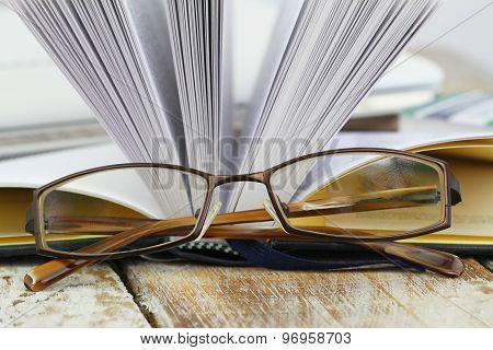 Glasses with open book in the background