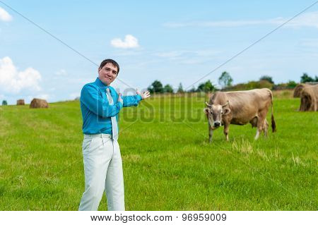 young businessman shows a good cow