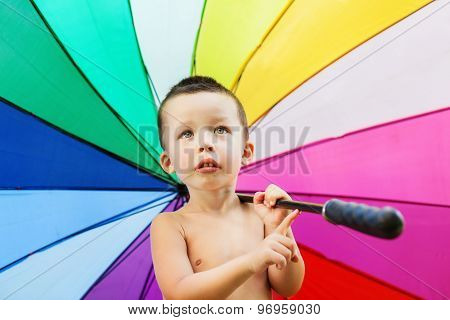 Portrait Of The Little Boy With Rainbow Colors Umbrella