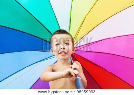 Cheerful Child Turning Big Colorful Umbrella