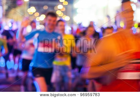 Blurred Marathon running race people competing in fitness and healthy active lifestyle feet on road