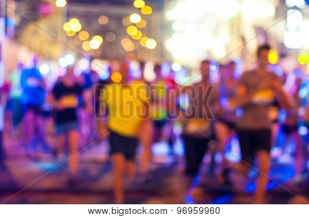 Blurred Runners shortly after the start at night run.  Bokeh background