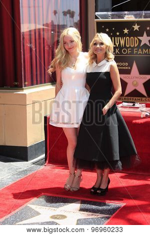 LOS ANGELES - JUL 24:  Dove Cameron, Kristen Chenoweth at the Kristin Chenoweth Hollywood Walk of Fame Star Ceremony at the Hollywood Blvd on July 24, 2015 in Los Angeles, CA