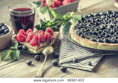 Tart with blueberries and juice on a wooden background. close-up