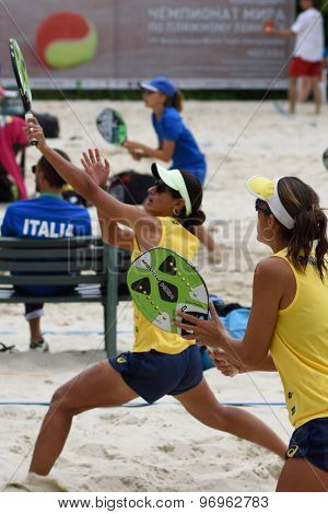 MOSCOW, RUSSIA - JULY 19, 2015: Joana Cortez (left) and Samantha Barijan of Brazil in the match for 3rd place of the Beach Tennis World Team Championship against Spain. Spain won the match