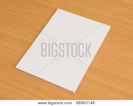 Blank papers on wooden office table.