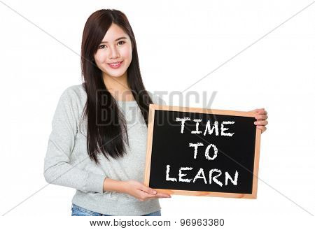 Young woman hold with chalkboard showing phrase time to learn