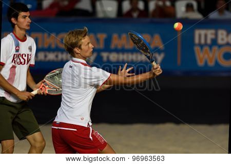 MOSCOW, RUSSIA - JULY 19, 2015: Daria Churakova (center) and Nikita Burmakin of Russia in the final match of the Beach Tennis World Team Championship against Italy. Italy become world champion