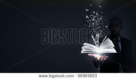 Close up of businessman showing media book on palm
