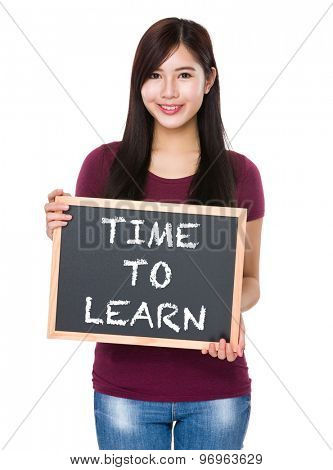 Asian woman with chalkboard showing phrase time to learn