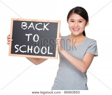Young student hold with black board showing phrase of back to school